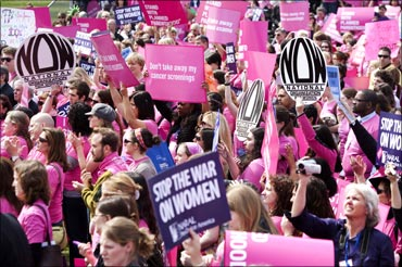 People hold a rally to support preventive healthcare and family planning services in the US.