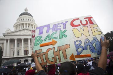 Thousands of college students and faculty protest at the State Capitol in Sacramento over balancing the budget.