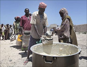 Internally displaced Somali people receive relief food in Madina district, southern Mogadishu.