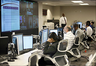 US Dept of Homeland Security analysts work at the National Cybersecurity Communications Center.