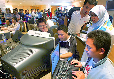 Malaysians participate in a computer attack and defence hacking competition.
