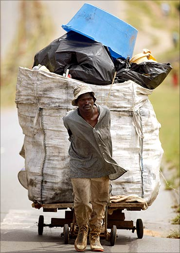 A jobless man pulls a trolley full of recyclable items in Orlando, Soweto in Aouth Africa.