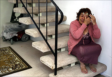Aida Lemus, 70, cries as she is evicted from her foreclosed condominium in Anaheim, California.