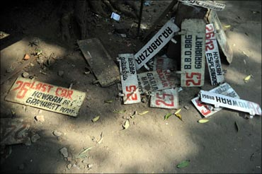 Route-boards scattered at the Gariahat tram depot.