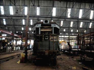 A senior citizen tram waiting for renovation at Nonapukur workshop.
