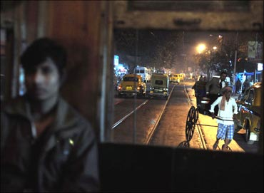 A tram moves through the narrow lanes of central Kolkata.