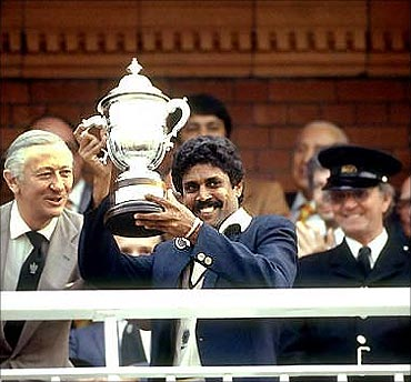 Kapil Dev holds the 1983 World Cup trophy.