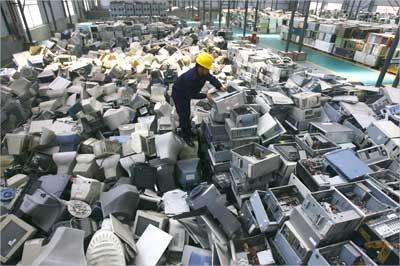 An employee arranges discarded computers at a newly opened electronic waste recycling factory in Wuhan.