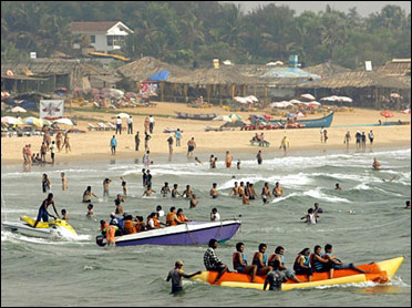 Tourists enjoy on Baga beach in Goa.