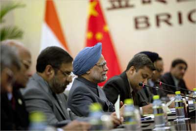Prime Minister Manmohan Singh (C) holds a bilateral meeting with China's President Hu Jintao (unseen) in Sanya.