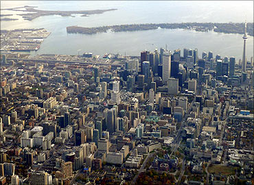 The downtown core of Toronto sits next to Lake Ontario in a picture taken from a commercial flight.