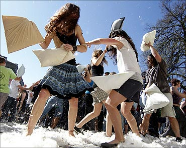 People attend a pillow fight in front of Zurich's catherdal on international Pillow Fight Day.