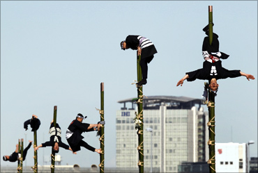 Edo Firemanship Preservation Association members perform atop bamboo ladders in Tokyo.