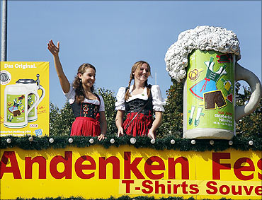 People in traditional Bavarian clothes take part in the 177th Oktoberfest in Munich.