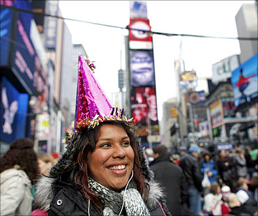 Daniela Calito from Los Angeles waits in Times Square during New Year's Eve celebrations in New York