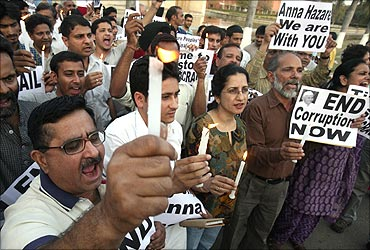 Supporters of Anna Hazare hold placards in a protest against corruption.