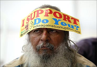 A demonstrator wears a sticker on his forehead during a protest rally against corruption.