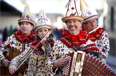Musicians dressed as traditional Flinserl participate in a carnival parade in Styria.