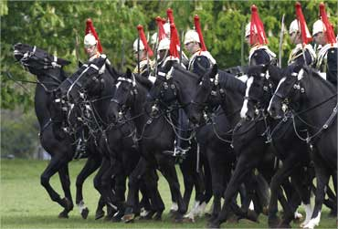 Members of the Household Cavalry take part in a dress rehearsal in Hyde Park, London.