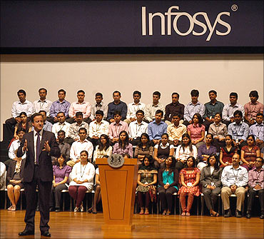 British Prime Minister David Cameron speaks during his visit at the Infosys campus.