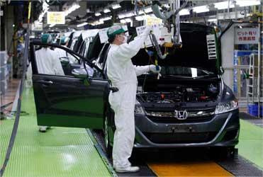 Workers assemble cars at Honda Motor's Saitama factory in Sayama, north of Tokyo.