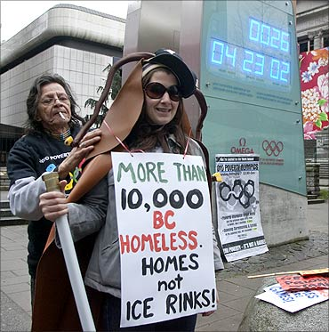 An anti-poverty protestor dressed as a cockroach, prepares to take part in a rally in Vancouver.