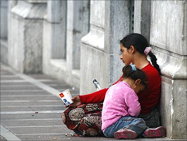 A beggar with her child in Athens.