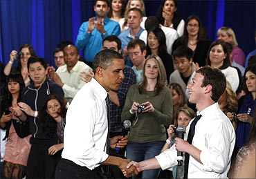 US President Barack Obama shakes hands with Facebook CEO Mark Zuckerberg at a townhall meeting at Facebook headquarters in Palo Alto, California..