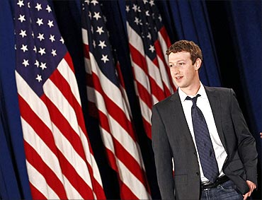 Facebook CEO Mark Zuckerberg arrives for the start of a town hall meeting with US President Barack Obama.