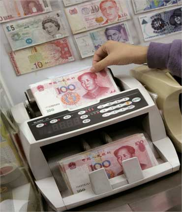 Yuan notes are counted at a currency exchange office in Hong Kong January.