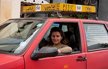A woman taxi driver in Fez.