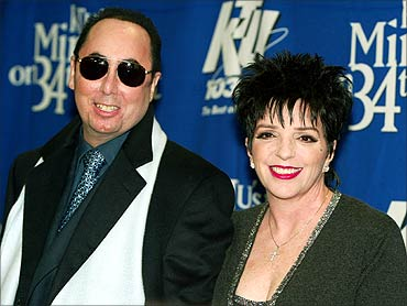 Singer Liza Minnelli and her husband David Gest pose for photographers