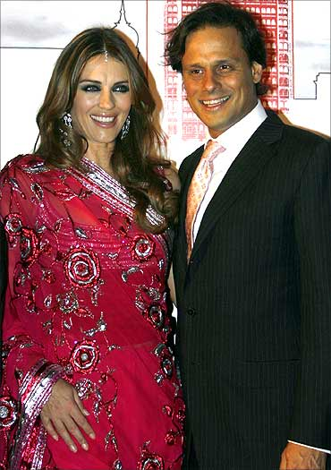 British actress Elizabeth Hurley poses with husband Arun Nayar.