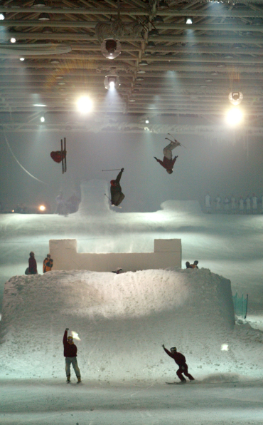 Skiers display their skills in a Madrid rink.