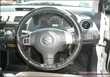 Steering wheel of Maruti Dzire.