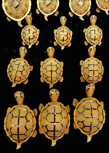 Gold turtles on display at a jewellery shop.