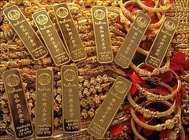 Gold bars and jewellery are displayed in a shop.