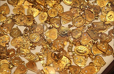Gold souvenirs are displayed at jewellery shop.