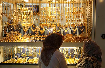 Women look at a jewellery shop.