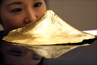 Pure gold artifact shaped as Japan's Mount Fuji by Japanese jewellery maker Ginza Tanaka.
