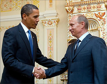President Barack Obama with Russian PM Vladimir Putin.
