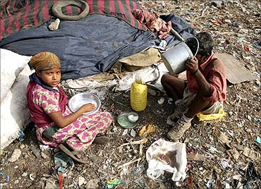 Rag pickers eat their lunch near a dump in New Delhi.