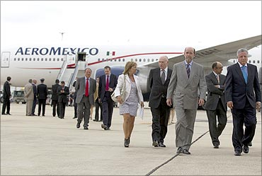 Authorities walk near an Aeromexico Boeing 777 after it landed in Madrid.