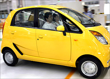Maharashtra Navnirman Sena (MNS) chief Raj Thackeray in a Nano.car