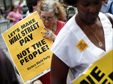 Activists demonstrate near Wall Street in protest of the massive budget cuts.