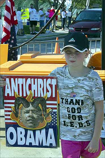 A young member of the Westboro Baptist Church of Topeka, Kansas, protests in Houston.