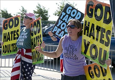 Members of the Westboro Baptist Church of Topeka, Kansas, protest as a call to prayer for a nation.
