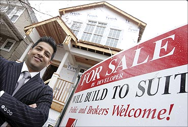 Developer Azeem Kahn poses outside a home he is building in Chicago.