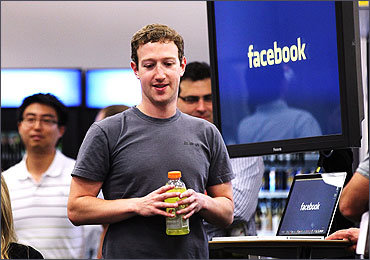 Facebook CEO Mark Zuckerberg prepares to speak at a news conference.