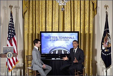 Twitter co-founder and executive chairman Jack Dorsey listens while President Barack Obama speaks.